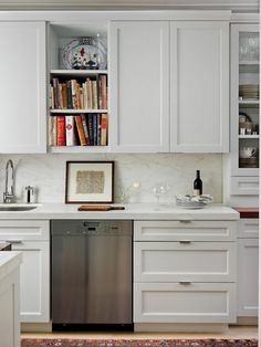 To refine a kitchen and its occasional disorder, tall cabinets in crisp white provide necessary storage for optimum functionality. Incorporate pops of color for delicious intrigue.