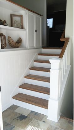 DIY split entry remodel, added storage, planking to tie the wall and cabinets together, changed railings, built newel, new slate tile floor.                                                                                                                                                     More