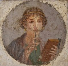 Fresco showing a woman holding writing implements, a wax tablet and stylus. Commonly called Sappho , the fresco actually portrays a high-society Pompeian woman, richly dressed with gold -threaded hair and large gold earrings. From Pompeii , ca. 50 CE. (Naples National Archaeological Museum)