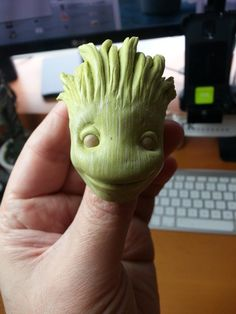 FREE TUTORIAL: really awesome dancing baby Groot. The head is made from a 2-part epoxy putty but polymer clay could also be used.