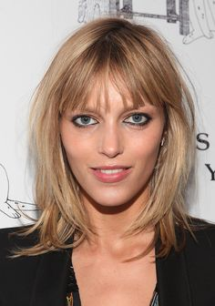 Anja Rubik Medium Layered Cut - Anja Rubik wore her hair in cool layers with wispy bangs at the Humane Society of New York's photography auction.