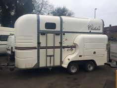 Clubstar trailer. Two horses, rear and side ramp, side lockers and overnight/camping living at the front.
