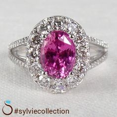 Think Pink with this stunning Oval Pink Sapphire Split Shank Halo Engagement Ring #SY509 http://www.sylviecollection.com/engagement.html