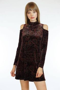 Velvet Cold Shoulder Dress ($92) Blend modern trends with retro-bohemian style for your next party look. This velvet dress features cold shoulder long sleeves, mock neck, and deep burgundy hues suitable for any swanky holiday gathering. Pair with tights and boots for colder evenings. Add a statement pendant for added glamour.