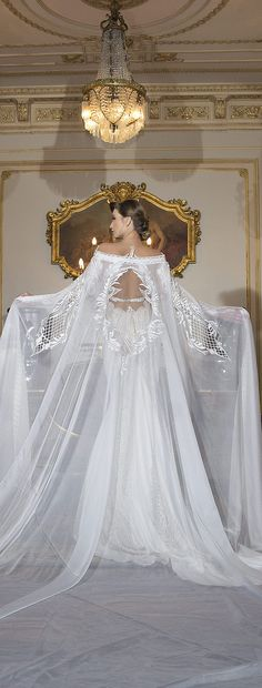Sheer bridal cape with cut-outs | Shabi & Israel - Haute Couture 2016 Bridal Collection via @BelleMagazine
