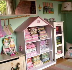 Dollhouses make great storage in a craft room, play room or anywhere! Maybe hanging on wall w/ some books ~ <3 ~ ! We brought in a 3 story dollhouse to our Let Nature sing Gifts! MW 3/19/16