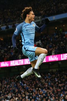 Leroy Sane of Manchester City celebrates scoring his sides first goal during the Premier League match between Manchester City and Tottenham Hotspur at the Etihad Stadium on January 21, 2017 in Manchester, England.