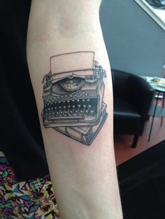 Manual typewriter and book tattoo - black - by O.Boy.Studios, Portland, Oregon - forearm tattoo, inner forearm, black work, etching