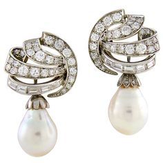 1stdibs - 1950's Pearl, Diamond & White Gold Handmade Day & Night Earrings explore items from 1,700  global dealers at 1stdibs.com
