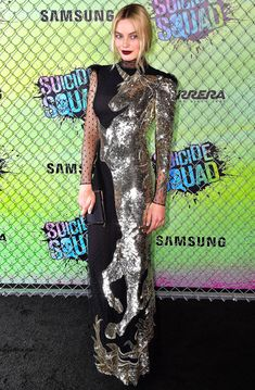 Margot Robbie in a gold sequin unicorn Alexander McQueen dress