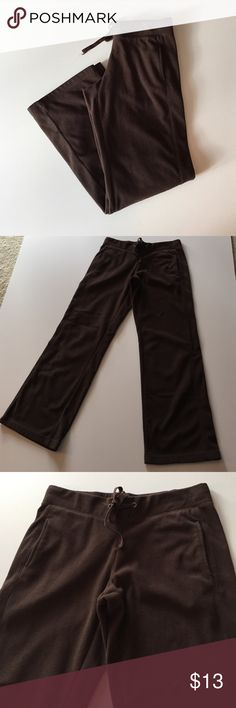 """Tek Gear Brown Fleece Sweatpants Excellent condition except for mark at back of right leg that is barely visible. See photo 4. Elastic waist with drawstring. 2 side pockets. 100% polyester. Waist 30"""". Inseam 31"""". 8.5"""" rise. Not from a smoke-free house. Tek Gear Pants Track Pants & Joggers"""