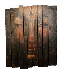 Buddha face on rustic wood painting