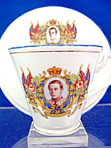 """Circa: 1936  Size: Cup 2 3/4"""" - 73mm tall. Saucer 5 5/8"""" 142mm across.  Manufacturer: Sutherland Bone China.    A bone china cup and saucer for the proposed 1937 coronation of King Edward VIII. Base marked Sutherland Bone china"""