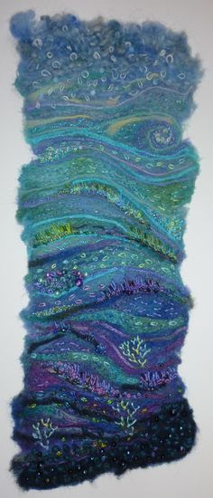 Seascape - Made by embellishing merino tops, silk bricks, ribbons and yarns onto a baby-wipe, then adding detail with hand embroidery and beads. by Su (Tiny Acorns) Harris.
