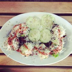 """Munch on the Cali Crunch! Raw & vegan sushi roll filled with protein-rich cauliflower hemp rice, walnut taco """"meat"""", avocado, marinated mushrooms, sprouts and paprika sauce drizzle. Visit us also at Main Street farmers market today-  we are starting to vend more of our delicacies!"""