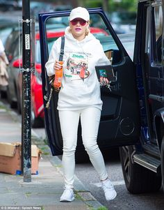 All white: Rita Ora stepped out in London after returning from New York City on…