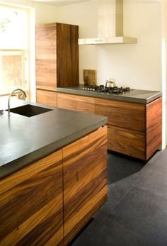 Caesarstone Raven Countertops with Wood Cabinets - what a beautiful match
