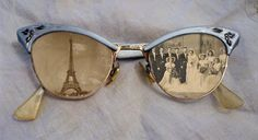 Got a pair of vintage eye glasses and don't know what to do with them? Add vintage photos behind the lenses and display.