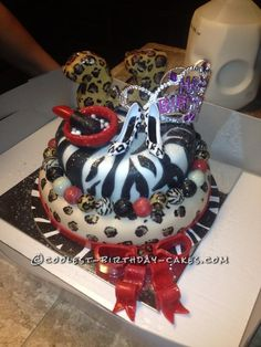 Coolest Leopard and Zebra Birthday Cake... This website is the Pinterest of birthday cake ideas