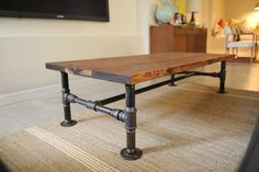 "DIY Industrial Coffee Table -- 3 cedar planks (2""x10""x however long you want), plumbing pipe, & about an hour to put it together - click for instructions & list of necessary parts"