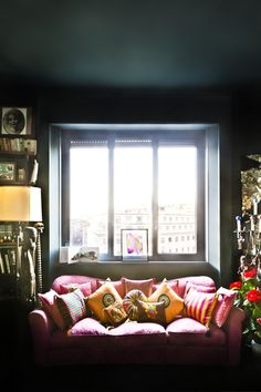 sofa and window - photo by beppe brancato