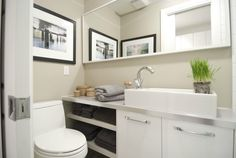 Nobody thought there was room for a functional bathroom in this small space but we were able to make it work by using a narrow sink and a pocket door.  @HGTV #IncomeProperty