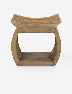 This unique accent piece provides two-fold functionality. Perfect in a reading nook, this reclaimed elm wood item acts as a stool or low table, and the shelf below provides storage for magazines and books.