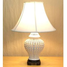 @Overstock.com - Openwork White Lace Porcelain Table Lamp - Add texture to any room with this unique porcelain table lamp. This lamp has a white lace finish that looks stylish, and the off-white double-lined bell shade complements to look of your home with a beautiful, soft glow that you'll enjoy.  http://www.overstock.com/Home-Garden/Openwork-White-Lace-Porcelain-Table-Lamp/6148647/product.html?CID=214117 $116.09