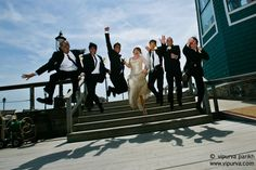 Karl Mendonca Weds Adele Ray. The bride and groom take the leap. The groomsmen join in.