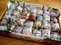 tomatoes wrapped in newspaper - storing/ripening green tomatoes (extend the harvest, bring them in before the frost)