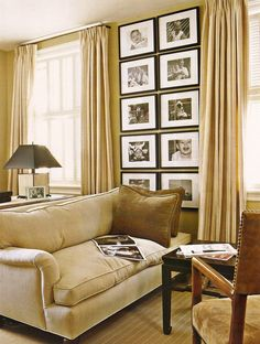 Warm tan gold monochrome living room. vertical gallery wall. Using a small space to creatively show off a collection.