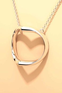 Shadow Heart silver necklace is designer jewelry that elegantly casts a silhouette of the heart symbol. This modern jewellery is a special gift for your love.