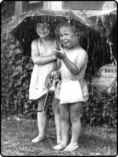 http://mistymorrning.tumblr.com/ - two girls - barefoot - under an umbrella - in the rain - one loving it - and one crying - black and white