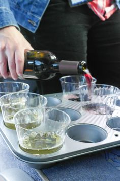 Life Hack: Portable Wine:  I was on a party bus a couple months ago and saw this GENIUS idea for serving wine. Cupcake pan + cups = portable wine party! I would totally do this with red Solo cups because that's how I roll. This would be genius for tailgating events, too. Or even for a low-key backyard wedding....