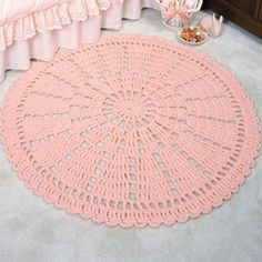 """Wheel Lace Rug Crochet ePattern - This lovely wheel of color would make a beautiful addition to any room in your home. The lacy look is especially pretty stitched in pink for a girl's room. It is crocheted using three strands of worsted weight yarn and a size N (9.00 mm) hook. Number of Designs: 1 rug Approximate Design Size: 38"""" diameter"""