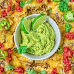 These crunchy and tasty Simple Black Bean Nachos are loaded with refried beans, caramelized onions, and cheese, and make a perfect snack or even lunch. Dip them in smashed avocados and enjoy! ❤ COOKTORIA.COM