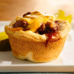 Cheesy, beefy, BBQ goodness - brown ground beef with a little onion; drain. Combine beef mixture with BBQ sauce. Like a cupcake pan with canned biscuits formed into cups; spoon in meat mixture, top with cheese, and bake at 375 until biscuits are cooked through.