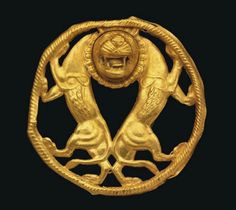 Achaemenid Gold Roundel c. 5th-4th Century BC  With two addorsed rampant lions, their hindquarters touching, necks joined by a single head with jaws gaping, teeth bared and tongue protruding, mane and whiskers delineated, their feet resting on incised circular border.