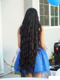 Very long black hair in ringlet curls.