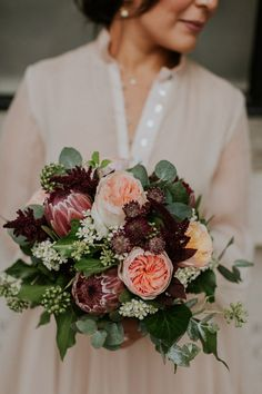 Protea, David Austin Roses and foliage bouquet Photo: @majatsolophotography