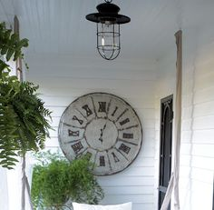 "I should update my front porch and put a large rustic clock up instead of the ""Welcome"" sign. Maybe I should make one myself...hmmmm."