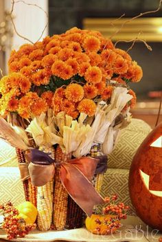 Indian corn wrapped around Mums-C2C Travels loves this fall destination wedding centerpiece! Take a break from planning your destination wedding travel and let us handle it for  you! http://2744.mtravel.com/