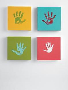 Love this.  Could buy small canvases and paint them, then do handprints.  Great wall art.
