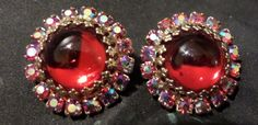 ended up going with these earrings, they look better with the wig and flash more bling and color