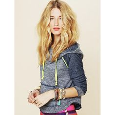 """Free People Blue Neon Details Hoodie Hooded pullover long sleeved sweatshirt with neon stitch detailing and drawstring ties at front of neckline. Slouchy, oversized neckline. Hems at sleeve and bottom are raw edge and lightly frayed. A casual cool piece to add some tomboy flair to your wardrobe.   65% Cotton, 35% Polyester. Machine Wash Cold.                                      Never worn, never washed. New condition!""""we the free"""" by Free People Free People Tops Sweatshirts & Hoodies"""