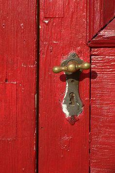 Pretty brass hardware on a red door. Old Doors, Windows And Doors, Barn Doors, Door Knobs And Knockers, Sliding Barn Door Hardware, Brass Hardware, Sliding Doors, Old Barns, Shades Of Red