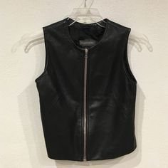 Banana Republic vest Excellent condition. Two spots shown will most likely come out. No trades. - Banana Republic Jackets & Coats Vests