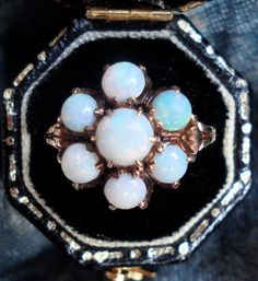 Antique Victorian Opal Flower Ring. From VictorianSpiritRings, via Etsy.