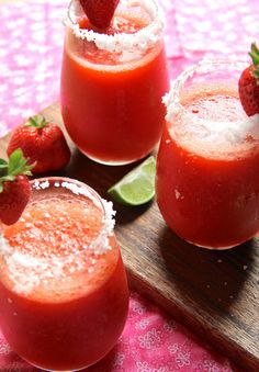 Frozen Strawberry Margaritas.                                                      6 ounces of tequila ( Cabo or patron ), 2 ozs. Grand Marnier, 1 quart of fresh strawberries,  3 limes, juiced, 3/4 cup water, 2 tablespoons agave nectar,                              3 to 4 cups of ice.