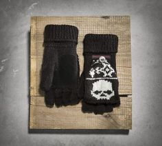 Total attitude and crazy warm. The Skull Fair Isle Mittens feature a flip-back style to transform into women's fingerless gloves. Convenient for a quick check on your weather app.  Seriously, do you really think cold and snow have a chance? If the warm sweater knit doesn't stop Old Man Winter, the skulls will.